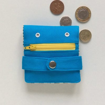 Blue Hug Monster Wallet - yellow zip- by Mika Bon Bon at The Red Door Gallery