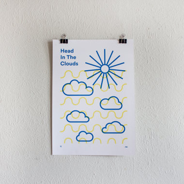 blue and yellow clouds and sunburst with text