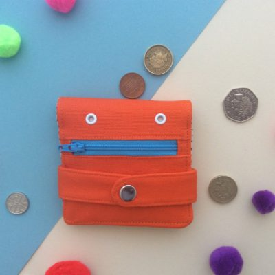 Orange Hug Monster Wallet - blue zip- by Mika Bon Bon at The Red Door Gallery