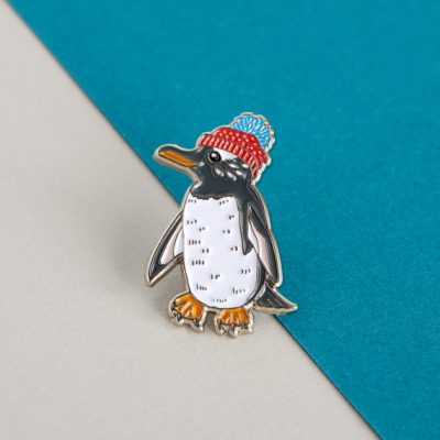 Penguin in a bobble hat enamel pin by Alice Tams