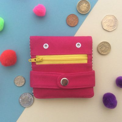 Pink Hug Monster Wallet by Mika Bon Bon at The Red Door Gallery