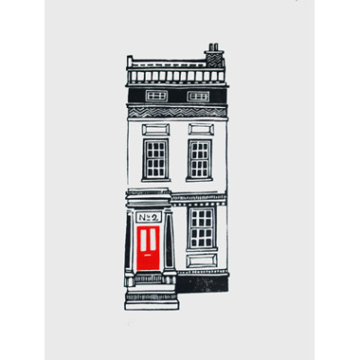 A black and white town house with a red door