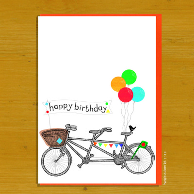 A tandem bike with a basket on the front and 4 baloons with bright envelope