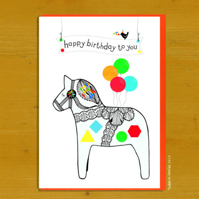 A beautiful Dala horse with colourful shapes and a bunch of baloons wishes you happy birthday