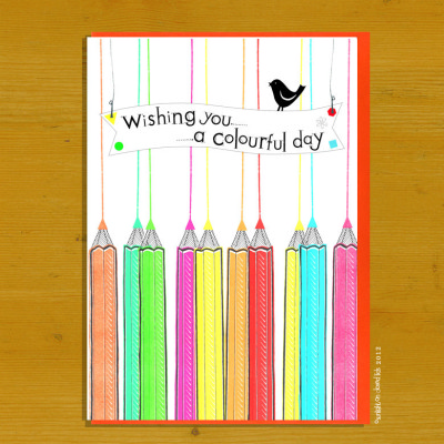 A colourful range of pencils draws lines across the card with bunting showing text as title