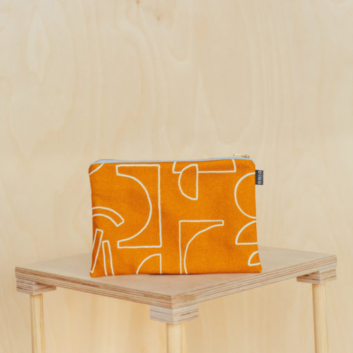 Line Tan Pouches by Ding Ding