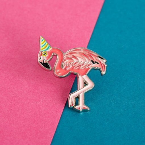 Flamingo in a party hat enamel pin by Alice Tams