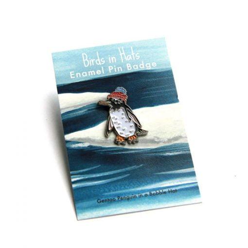 Penguin in a bobble hat enamel pin by Alice Tams