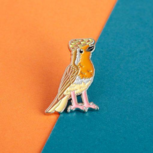 Robin in a flat cap enamel pin by Alice Tams