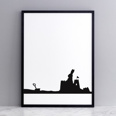 seaside rabbit print in a black frame